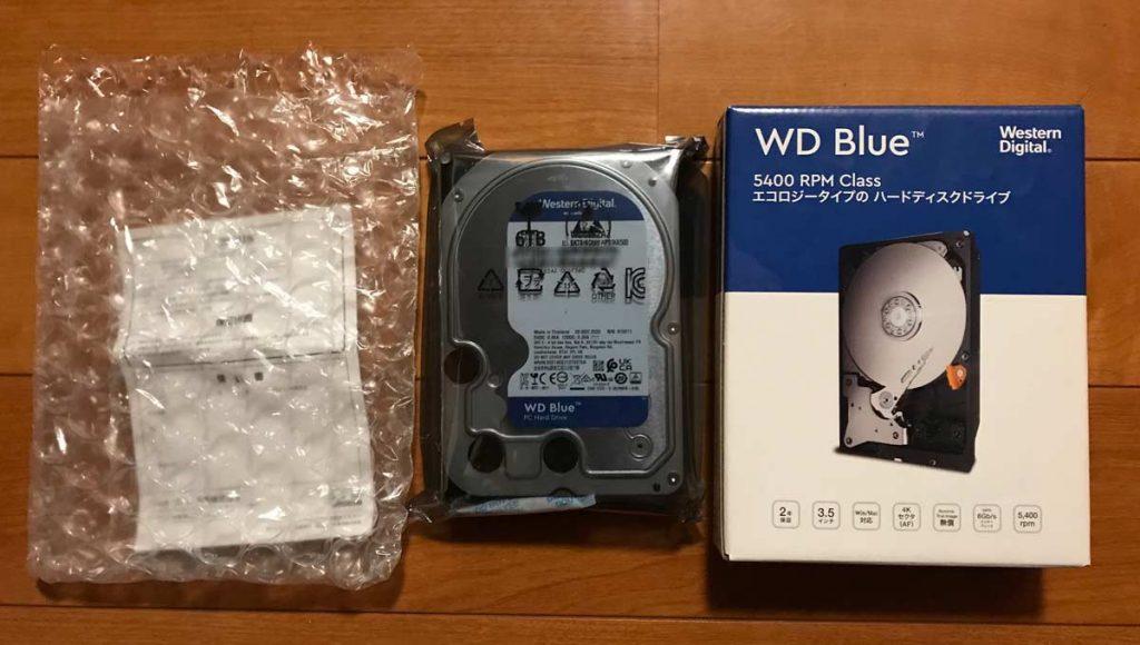 HDD外箱と静電気防止袋、エアクッションの画像